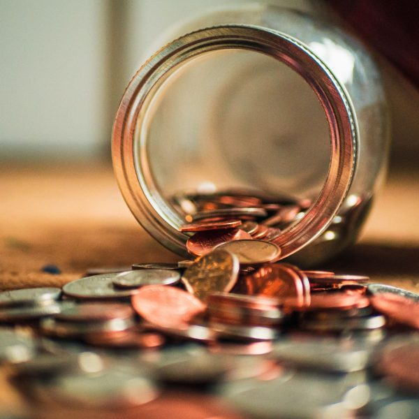 Pennies in a tipped jar. How has the Covid-19 pandemic affected credit management?